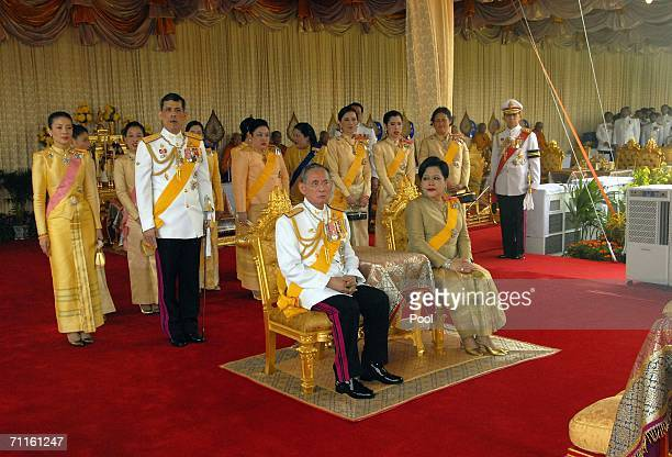 Thailand's King Bhumibol Adulyadej and Queen Sirikit sit infront of the Thai Royal family at the Royal Plaza on June 9 2006 in Bangkok Thailand...