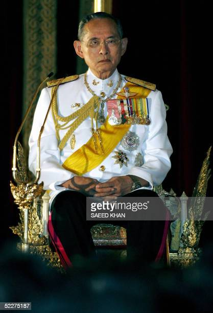 Thailand's King Bhumibol Adulyadej attends a brief traditional ceremony prior to formally inaugurating a new session of parliament following last...