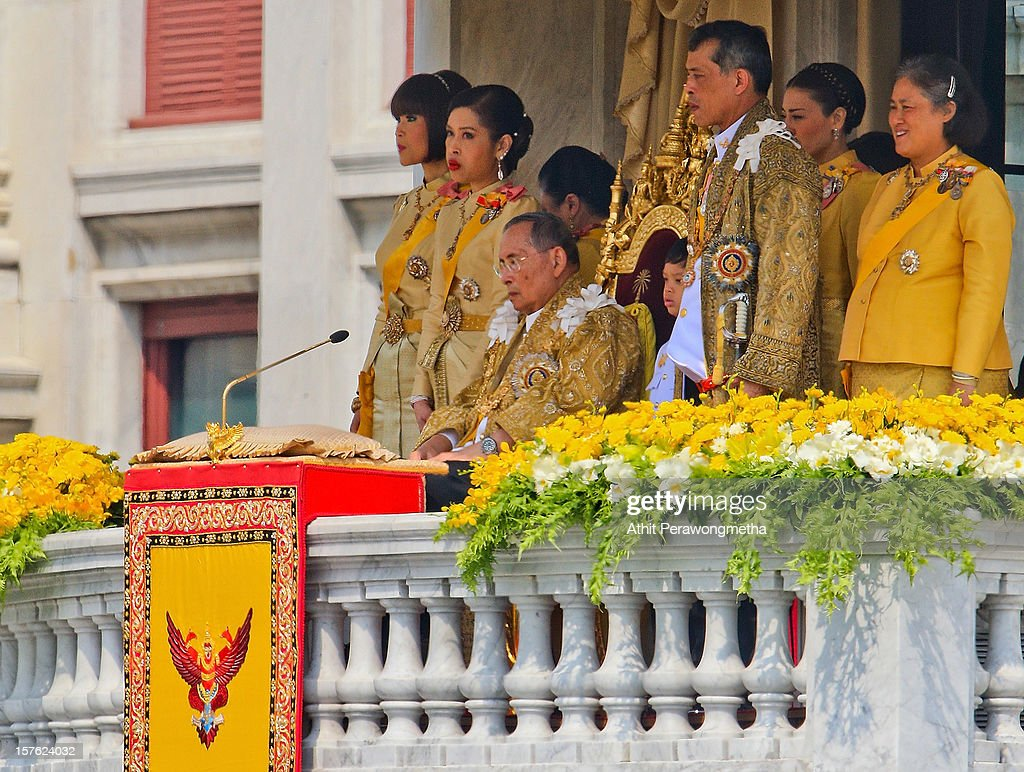 Thailand's King Bhumibol Adulyadej is surrounded by his Daugthers Princess Ubol Ratana (L), Chulabhorn (2L), His son Crown Prince Vajiralongkorn (2R) and Princess Maha Chakri Sirindhorn on the occasion of his his 85th birthday, as tens of thousands come to pay respect and get a rare chance to see him in person, on December 5, 2012 in Bangkok, Thailand. King Bhumibol took the throne in 1946, making him Thailand's longest reigning monarch and is currently the world's longest serving head of state. Yellow represents Monday, the birthday of the King.