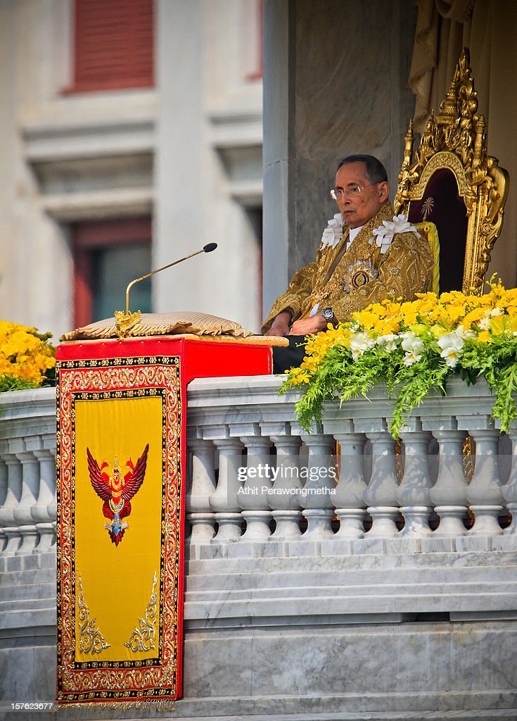 Thailand's King Bhumibol Adulyadej makes a rare public appearance on the occasion of his his 85th birthday, as tens of thousands come to pay respect and get a rare chance to see him in person, on December 5, 2012 in Bangkok, Thailand.King Bhumibol took the throne in 1946, making him Thailand's longest reigning monarch and is currently the world's longest serving head of state. Yellow represents Monday, the birthday of the King.