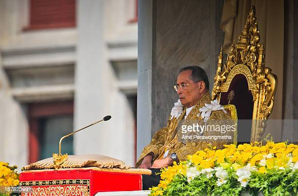 Thailand's King Bhumibol Adulyadej makes a rare public appearance on the occasion of his his 85th birthday as tens of thousands come to pay respect...