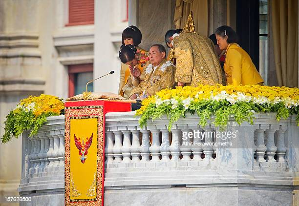 Thailand's King Bhumibol Adulyadej receives respect from members of the Royal Family on the occasion of his his 85th birthday as tens of thousands...