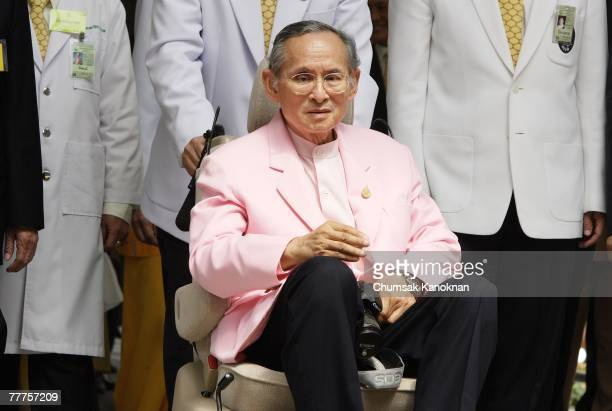 Thailand's King Bhumibol Adulyadej sits on a wheelchair as he leaves the Siriraj hospital on November 7 in Bangkok Thailand The 79 yearold King is...