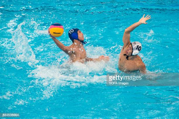 Thailand's Kirasit Patarathitina of Thailand attacks against Malaysia's Daryl Khoo Tiong Jin in the men's water polo round robin match during the...