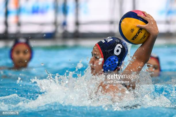 Thailand's Kornkarn Puengpong prepares to score a goal against Singapore during their women's water polo round match at the 29th Southeast Asian...