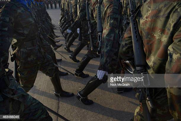 Thailand's military forces march as they mark the 2014 Thai Armed Forces day with a military parade at the 2nd Cavalry Division Kings Gaurd Barracks...