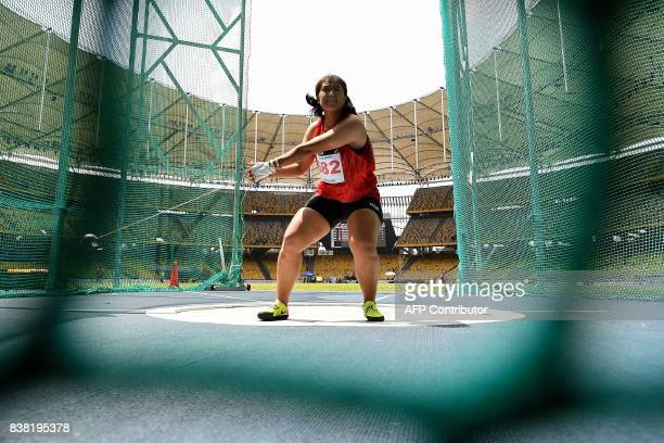 Thailand's Mingkamon Koomphon competes in the women's hammerthrow athletics final of the 29th Southeast Asian Games at the Bukit Jalil national...