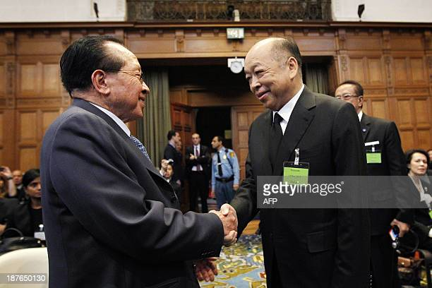 Thailand's minister of Foreign Affairs Surapong Tovichakchaikul and his Cambodian counterpart Hor Namhong arrive for the trial between Cambodia and...
