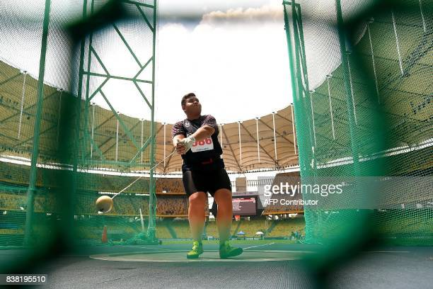Thailand's Panwat Gimsrang competes in the women's hammerthrow athletics final of the 29th Southeast Asian Games at the Bukit Jalil national stadium...