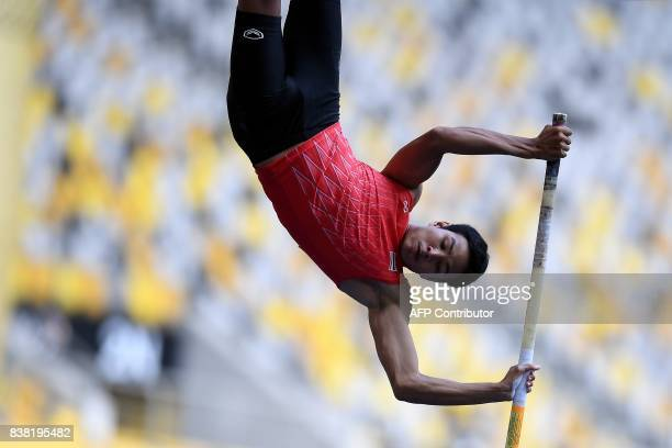 Thailand's Porranot Purahong competes in the men's polevault athletics final of the 29th Southeast Asian Games at the Bukit Jalil national stadium in...