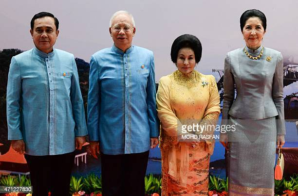 Thailand's Prime Minister Prayut ChanOCha and his wife Naraporn Malaysian Prime Minister Najib Razak and his wife Rosmah Mansor pose for a group...