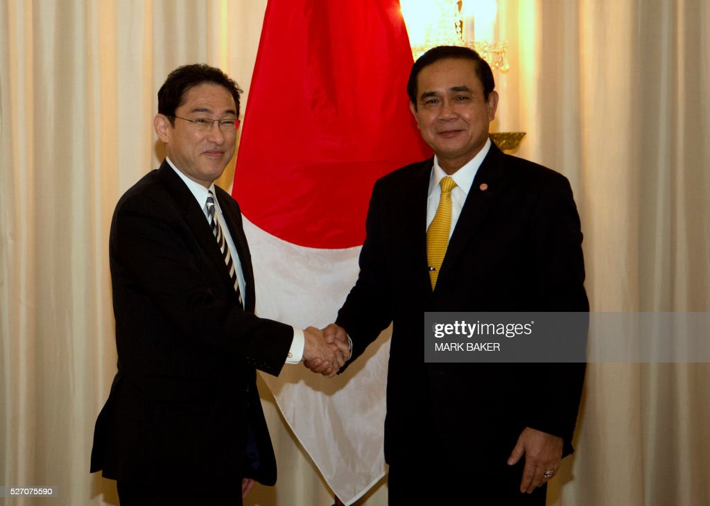 CORRECTION - Thailand's Prime Minister Prayut Chan-O-Cha (R) meets with Japan's Minister of Foreign Affairs Fumio Kishida at Government House in Bangkok on May 2, 2016. / AFP / POOL / Mark Baker / The erroneous mention appearing in the metadata of this photo by Mark Baker has been modified in AFP systems in the following manner: completes Thai Prime Minister's name [Prayut Chan-O-Cha] instead of [Chan-O-Cha]. Please immediately remove the erroneous mention from all your online services and delete it from your servers. If you have been authorized by AFP to distribute it to third parties, please ensure that the same actions are carried out by them. Failure to promptly comply with these instructions will entail liability on your part for any continued or post notification usage. Therefore we thank you very much for all your attention and prompt action. We are sorry for the inconvenience this notification may cause and remain at your disposal for any further information you may require.