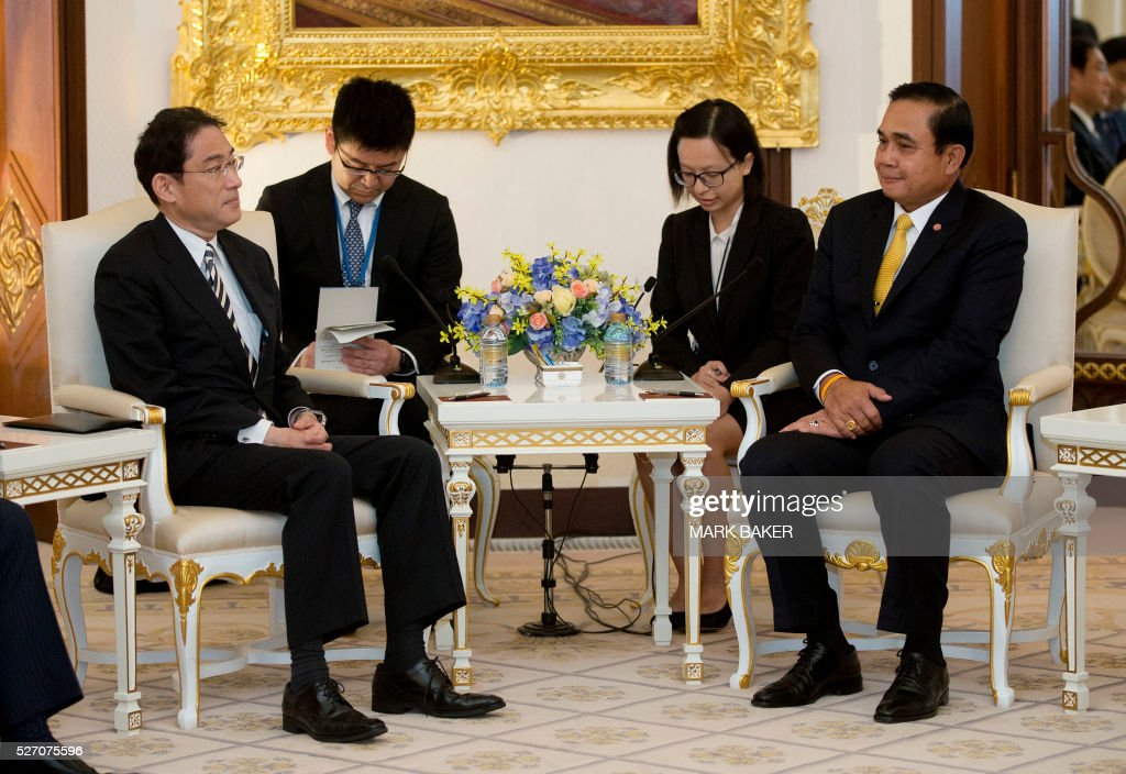 Thailand's Prime Minister Chan-O-Cha (R) sits with Japan's Minister of Foreign Affairs Fumio Kishida (L) during talks at Government House in Bangkok on May 2, 2016. / AFP / POOL / Mark Baker