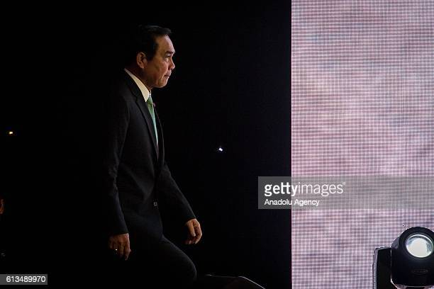Thailand's Prime Minister Prayut ChanoCha walks to the stage at the Plaza Athenee Hotel to give a speech on 'The Indispensable Role of Business in...