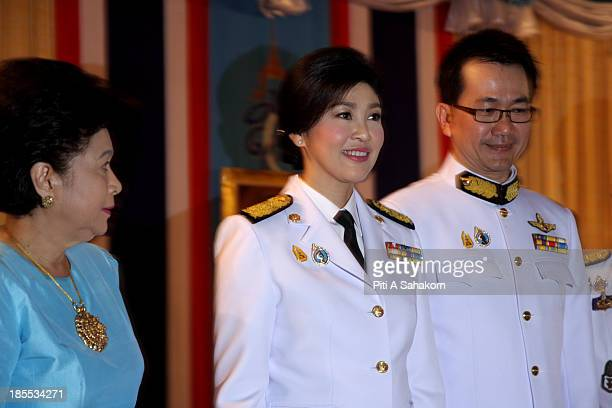 Thailand's prime minister Yingluck Shinawatra during a ceremony for Queen Sirikit's 81st birthday at the royal field Their Majesties the King and...