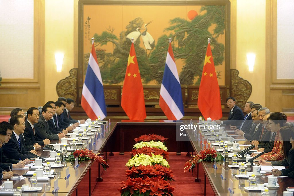 Thailand's Prime Minister Yingluck Shinawatra (3rd R) holds talks with Chinese Prime Minister Wen Jiabao (2nd L) at the Great Hall of the People on April 17, 2012 in Beijing April. 17, 2012. Yingluck Shinawatra is on a four day visit to China during which the focus in discussions will be on the strengthening of trade relations.