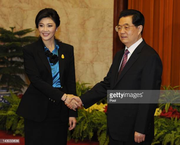 Thailand's Prime Minister Yingluck Shinawatra shakes hands with Chinese President Hu Jintao as they meet to hold talks at the Great Hall of the...