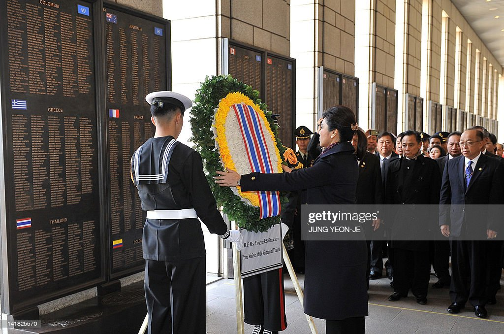 Thailand's Prime Minister Yingluck Shinawatra takes part in a wreathlaying ceremony as she visits the Korean War Memorial in Seoul on March 25 2012...