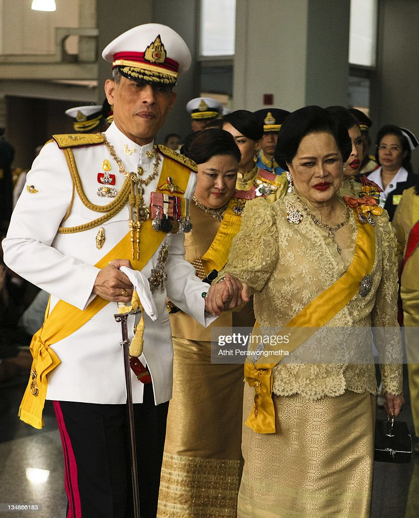 Thailand's Queen <a gi-track='captionPersonalityLinkClicked' href=/galleries/search?phrase=Sirikit&family=editorial&specificpeople=228360 ng-click='$event.stopPropagation()'>Sirikit</a> and Crown Prince <a gi-track='captionPersonalityLinkClicked' href=/galleries/search?phrase=Maha+Vajiralongkorn&family=editorial&specificpeople=584948 ng-click='$event.stopPropagation()'>Maha Vajiralongkorn</a> follow King Bhumibol Adulyadej, as he returns from The Grand Palace to Siriraj Hospital on December 5, 2011 in Bangkok, Thailand. King Bhumibol is celebrating his 84th birthday today and is Thailand's longest serving monarch, having reigned as King since 1946.