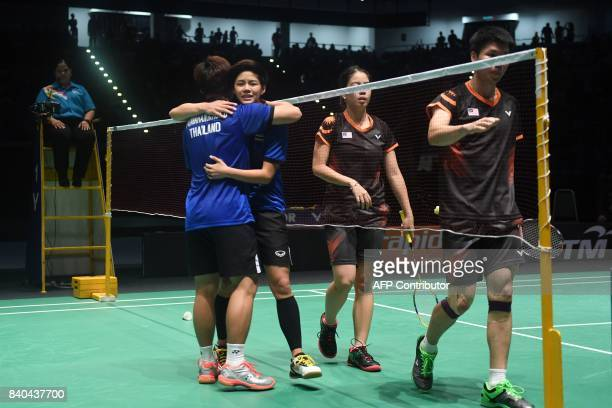 Thailand's Sapsiree Taerattanachai and Dechapol Puavaranukroh celebrate after their victory against Goh Soon Huat and Shevon Jemie Lai of Malaysia...