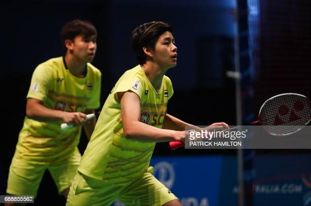 Thailand's Sapsiree Taerattanachai and partner Dechapol Puavaranukroh prepare to return a shot during the mixed doubles Sudirman Cup match against...