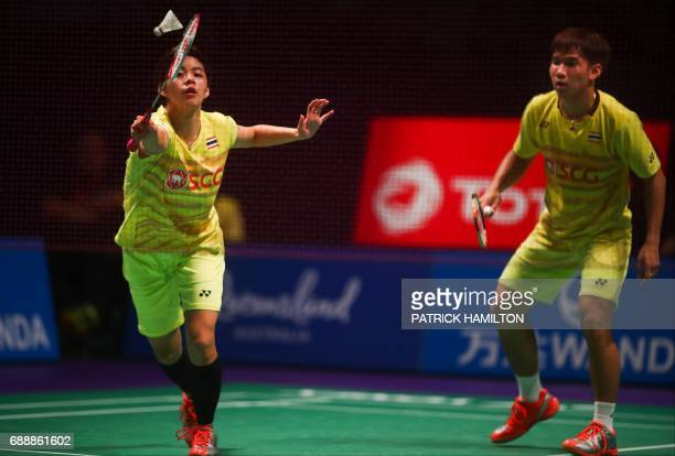 Thailand's Sapsiree Taerattanachai hits a return with partner Dechapol Puavaranukroh during the mixed doubles Sudirman Cup match against Chae Yoo...