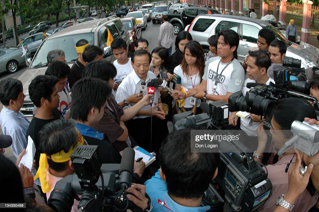 Thailand's Social Venture Network Vice President Prasarn Marukpitak speaks to reporters before tonight's anti-Prime Minister <a gi-track='captionPersonalityLinkClicked' href=/galleries/search?phrase=Thaksin+Shinawatra&family=editorial&specificpeople=220948 ng-click='$event.stopPropagation()'>Thaksin Shinawatra</a> rally in Lumpini Park, Bangkok, Thailand