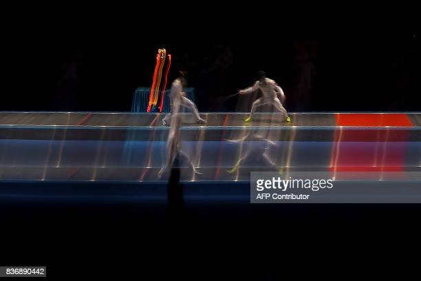 Thailand's Sopanut Mayakarn competes with Brennan Wayne Louie of the Philippines in the men's fencing foil individual semifinal of the 29th Southeast...