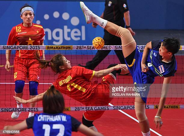 Thailand's striker Sasiwimol Janthasit plays against Vietnam's Duong Thi Xuyen during their sepak takraw women's regu semifinals at the 28th...
