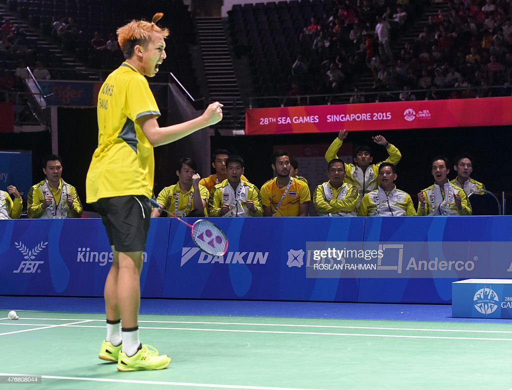 Thailand s Tanongsak Saensomboonsuk L reacts after a point
