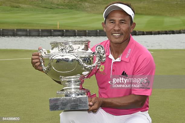 Thailand's Thongchai Jaidee poses with the trophy after winning the 100th French Golf Open on July 3 2016 at Le Golf National in Guyancourt near...