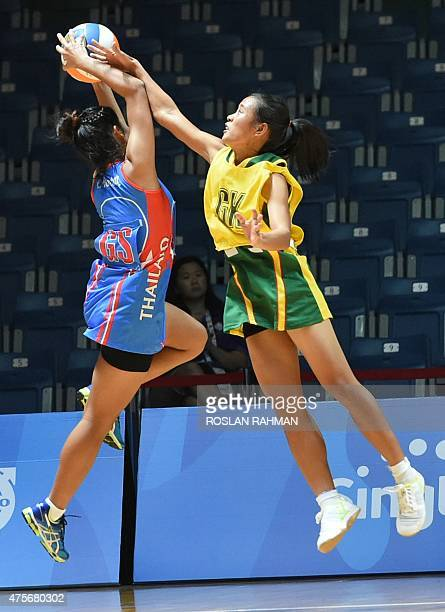 Thailand's Yada Boonkong fights for the ball with Myanmar's Mon Khin Aye during the women's netball preliminary round between Thailand and Myanmar at...