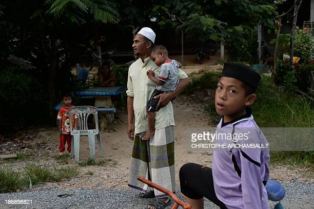 ThailandunrestsouthmilitaryFEATURE by Aidan JONES This picture taken on September 19 2013 shows Thai Muslim man Abdulmalae Usao the stepfather of...