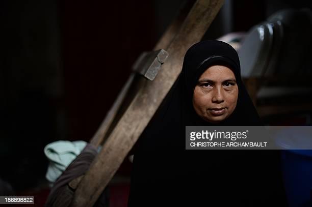 ThailandunrestsouthmilitaryFEATURE by Aidan JONES This picture taken on September 19 2013 shows Thai Muslim woman Mariyea Bersa the mother of Lookman...