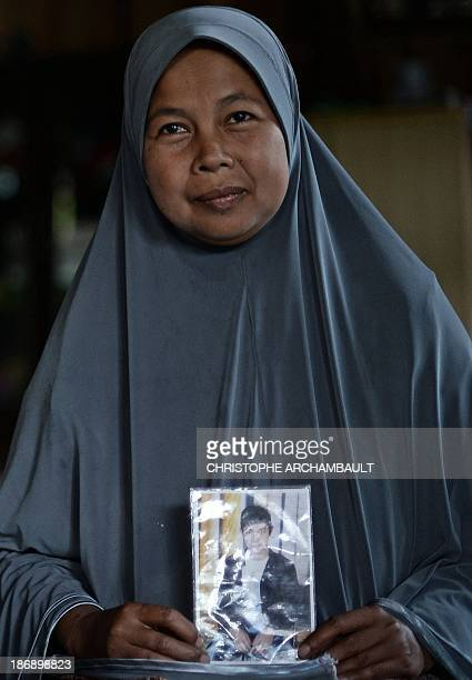 ThailandunrestsouthmilitaryFEATURE by Aidan JONES This picture taken on September 19 2013 shows Thai Muslim woman Ruhani Hayeemalee holding a picture...