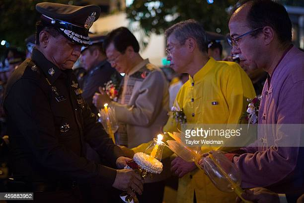 Thais and foreigners take part in a candlelighting ceremony in honor of the King's birthday on December 3 2014 in Chiang Mai Thailand December 5th...