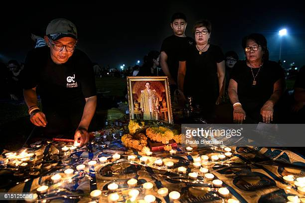 Thai's pray and light candles in memory of the late King of Thailand outside the Grand Palace on October 16 2016 in Bangkok Thailand Thailand's King...