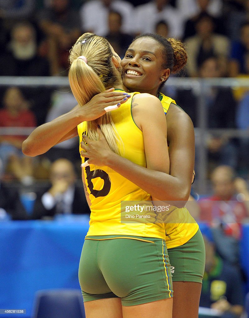 Thaisa Menezes (L) and Fabiana Claudino of Brazil celebrate victory after the FIVB Women's World Championship pool Brankica Mihajlovic of Serbia B match between on September 28, 2014 in Trieste, Italy.