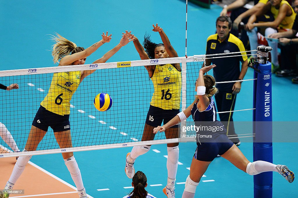 Thaisa Menezes (L) and Fernanda Rodrigues (R) of Brazil blocks an attack during day three of the FIVB World Grand Prix Sapporo 2013 match between Brazil and Italy at Hokkaido Prefectural Sports Center on August 30, 2013 in Sapporo, Hokkaido, Japan.