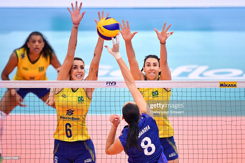 Thaisa Menezes of Brazil block the ball from Nataliya Goncharova of Russia during day two of the FIVB World Grand Prix Group 1 Final on July 7, 2016 in Bangkok, Thailand.