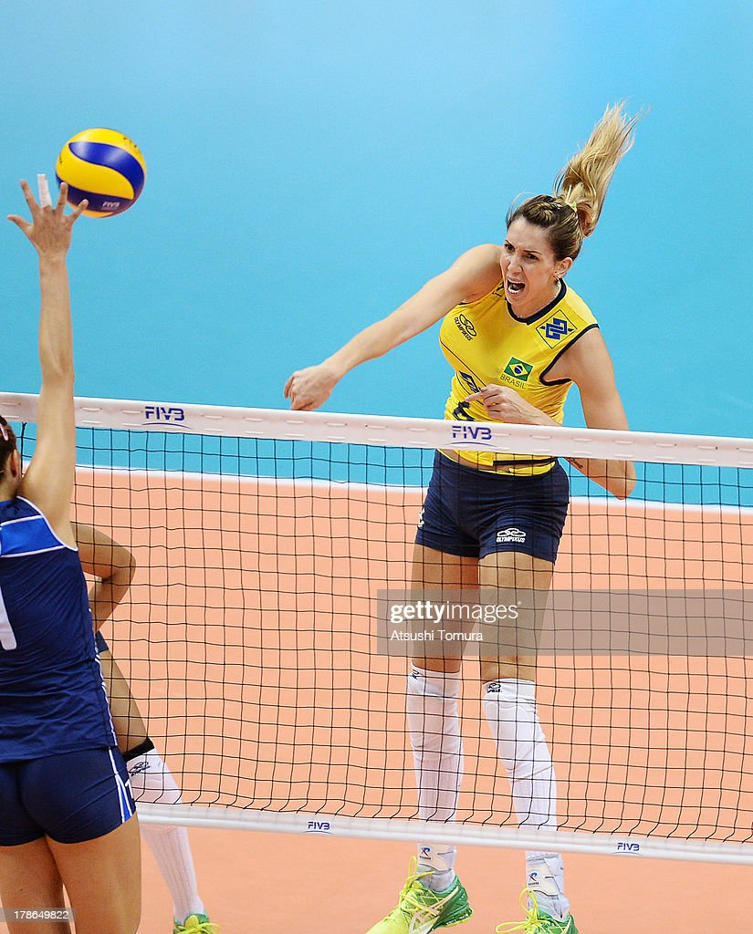 <a gi-track='captionPersonalityLinkClicked' href=/galleries/search?phrase=Thaisa+Menezes&family=editorial&specificpeople=4408968 ng-click='$event.stopPropagation()'>Thaisa Menezes</a> of Brazil spikes the ball during day three of the FIVB World Grand Prix Sapporo 2013 match between Brazil and Italy at Hokkaido Prefectural Sports Center on August 30, 2013 in Sapporo, Hokkaido, Japan.