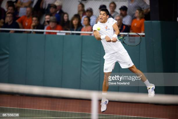 ThaiSon Kwiatkowski of the University of Virginia hits the ball during the Division I Men's Tennis Championship held at the Dan Magill Tennis Complex...