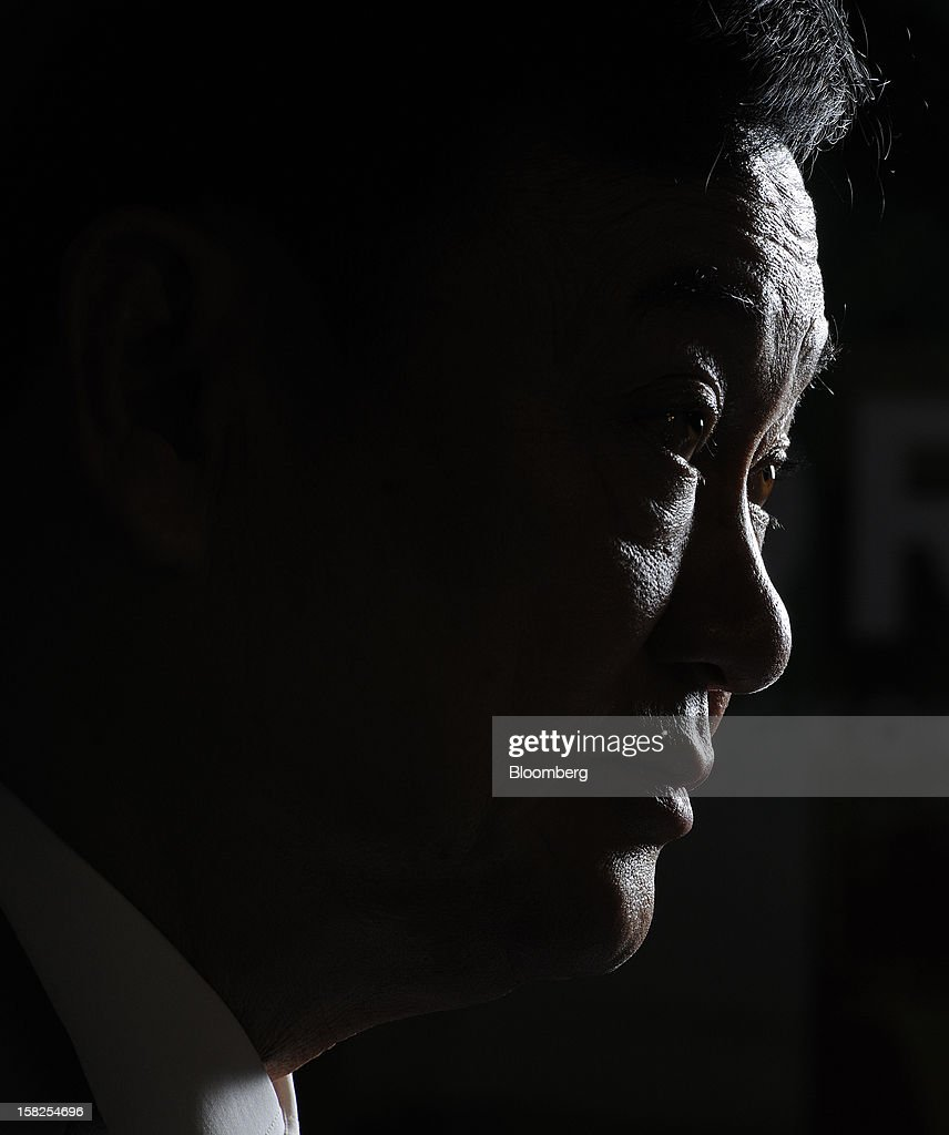 'BEST PHOTOS OF 2012' (): <a gi-track='captionPersonalityLinkClicked' href=/galleries/search?phrase=Thaksin+Shinawatra&family=editorial&specificpeople=220948 ng-click='$event.stopPropagation()'>Thaksin Shinawatra</a>, former prime minister of Thailand, pauses during an interview in Singapore, on Monday, Sept. 24, 2012. Thaksin said a rice-purchase program should be extended for several more years, rebuffing critics who say the policy has increased government debt and encouraged corruption. Photographer: Munshi Ahmed/Bloomberg via Getty Images