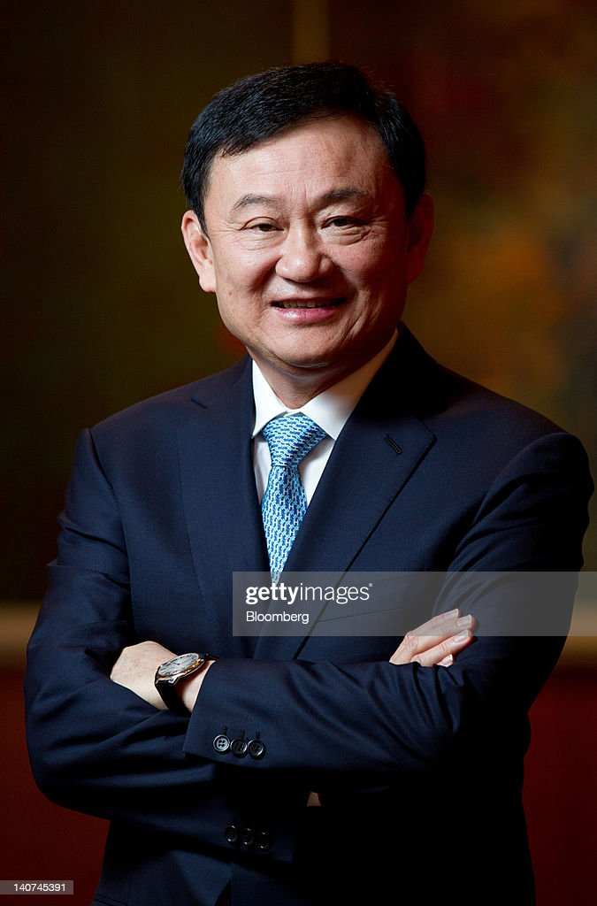 <a gi-track='captionPersonalityLinkClicked' href=/galleries/search?phrase=Thaksin+Shinawatra&family=editorial&specificpeople=220948 ng-click='$event.stopPropagation()'>Thaksin Shinawatra</a>, former prime minister of Thailand, poses for a photograph at the Asian Leadership Conference in Seoul, South Korea, on Tuesday, March 6, 2012. Thailand's feuding political rivals will reconcile this year and avoid a violent confrontation similar to those that occurred during a previous effort to change the constitution, Thaksin said. Photographer: SeongJoon Cho/Bloomberg via Getty Images