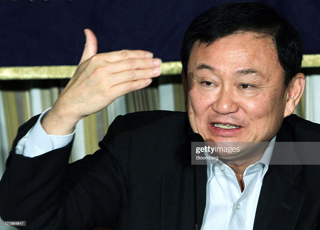 <a gi-track='captionPersonalityLinkClicked' href=/galleries/search?phrase=Thaksin+Shinawatra&family=editorial&specificpeople=220948 ng-click='$event.stopPropagation()'>Thaksin Shinawatra</a>, former prime minister of Thailand, speaks during a news conference at the Foreign Correspondents' Club of Japan (FCCJ) in Tokyo, Japan, on Tuesday, Aug. 23, 2011. The exiled Thai leader said he doesn't have plans to return home immediately and that he would only do so once rifts within the country had been healed. Photographer: Haruyoshi Yamaguchi/Bloomberg via Getty Images