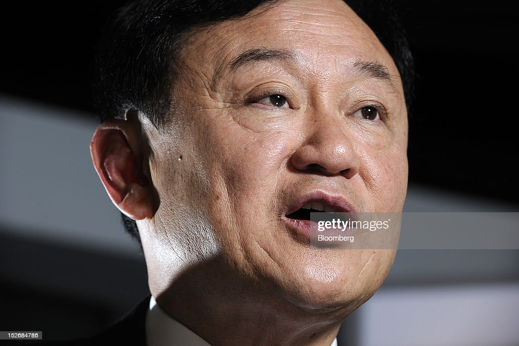 <a gi-track='captionPersonalityLinkClicked' href=/galleries/search?phrase=Thaksin+Shinawatra&family=editorial&specificpeople=220948 ng-click='$event.stopPropagation()'>Thaksin Shinawatra</a>, former prime minister of Thailand, speaks during an interview in Singapore, on Monday, Sept. 24, 2012. Thaksin said a rice-purchase program should be extended for several more years, rebuffing critics who say the policy has increased government debt and encouraged corruption. Photographer: Munshi Ahmed/Bloomberg via Getty Images