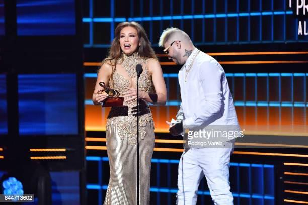 Thalia and Farruko speak onstage during Univision's 29th Edition of Premio Lo Nuestro A La Musica Latina at the American Airlines Arena on February...