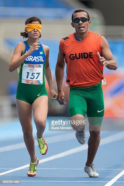 Thalita Vitoria Simplicio da Silva competes with her guide Felipe Veloso da Silva the Women's 400m T11 Final during the Paralympics Athletics Grand...