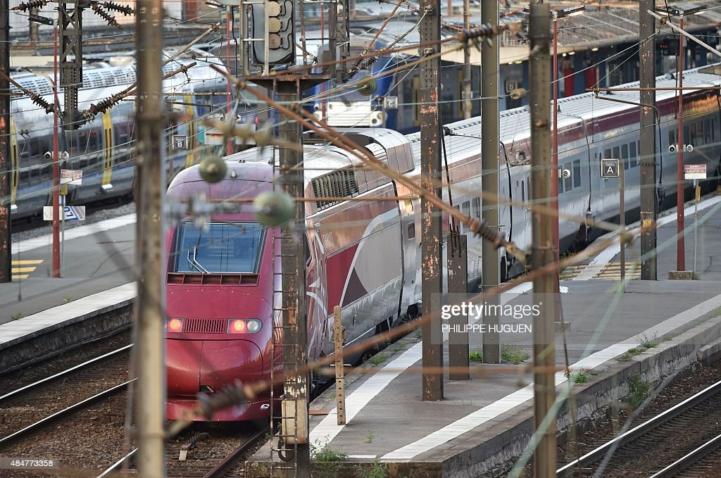 A Thalys train of French national railway operator SNCF stands at the main train station in Arras northern France on August 21 2015 A gunman opened...