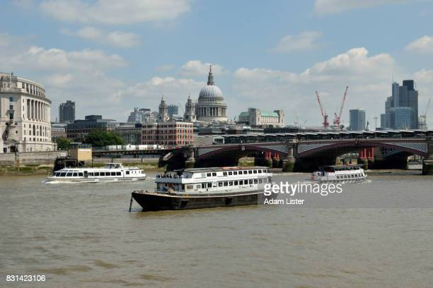 Thames boats before St Pauls Cathedral